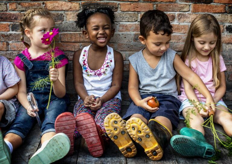 Children sitting next to each other
